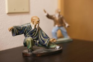 Small, glazed and painted clay figurines of Traditional Yang Family Tai Chi practitioners at the Eugene Yang Chengfu Tai Chi Chuan Center.