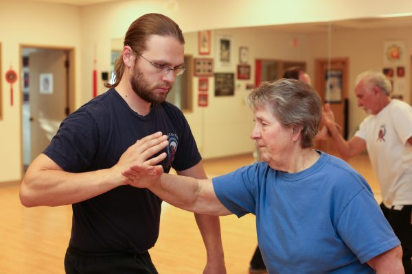 Eugene Yang Chengfu Tai Chi Chuan Center instructors, Andrew Holmes-Swanson and Barbara Wallace, practice Push Hands.