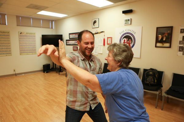 Eugene Yang Chengfu Tai Chi Chuan Center instructor Barbara Wallace practices Push Hands with center director and fellow instructor, Dr. Greg Moore.