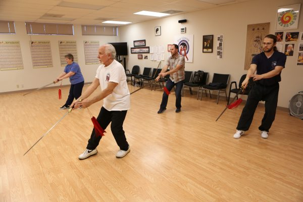 Dr. James Fox, PhD leads his fellow instructors in a Sword Form class at the Eugene Yang Chengfu Tai Chi Chuan Center.