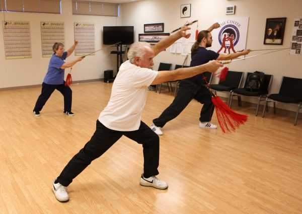 Dr. James Fox, PhD instructs a class in Weapons: Sword Form, the art of Tai Chi self-defense.